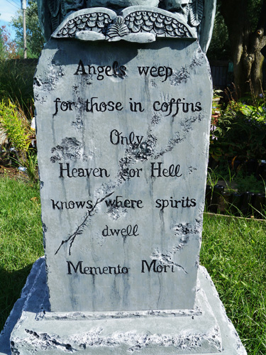 Angel of death tombstone with lettering