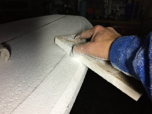 shaping surfboard